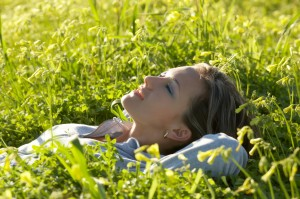 http://www.dreamstime.com/stock-images-close-up-girl-lying-green-grass-image4528944