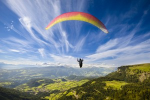 http://www.dreamstime.com/stock-image-paraglider-flying-over-mountains-summer-day-image45678011