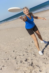 http://www.dreamstime.com/royalty-free-stock-images-fit-healthy-senior-woman-playing-frisbee-deserted-beach-sea-image29788179